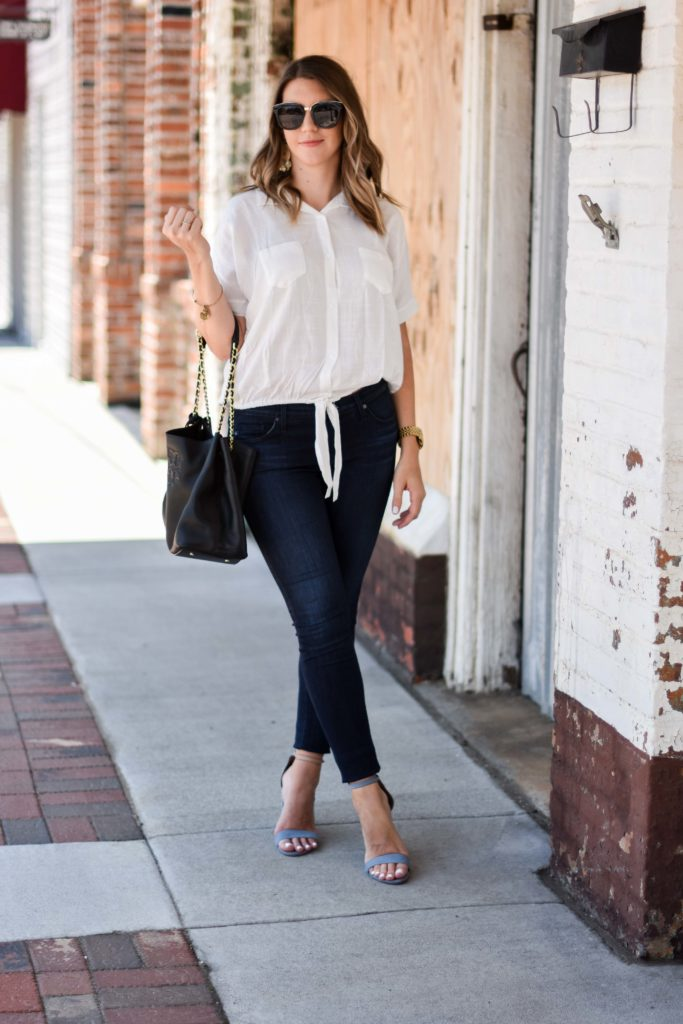 white tie up top ag jeans tory burch bag